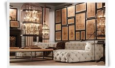 Love love love the wall of sepia sketches; and the birdcage/chandelier idea.. and that sofa {it's definitely not a couch} is unbelievable.