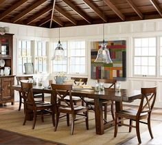 benchwright extending tables + aaron chairs (and I like the natural rug over the wood floors)