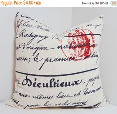 Navy french script pillow on Natural color background with red stamp Medium weight cotton designer fabric with Zipper closure.    Choose size at