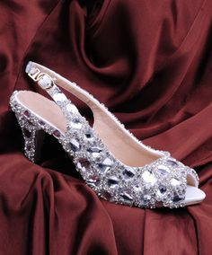 These quinceanera shoes are a nice choice if you want a heel that's not too high!  http://myperfectquince.com/quinceanera-shoes-changing-of-the-shoes-ceremony/
