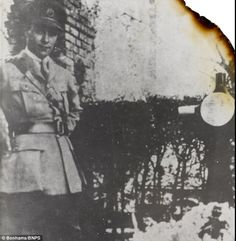 Lieutenant Donald Fraser, pictured here standing by the Red Baron's grave, wrote the account of his death