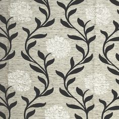 A good quality flock printed fabric on an unusual background.     The background has a faux silk style to it, and the fabric is flock printed in a Black flock print, which is also overprinted with a Silver contemporary flower.