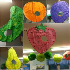 Preschool Toddler classroom: The Very Hungry Caterpillar ceiling decor! Caterpillar made of huge tissue paper poms & food hanging made out of coffee filters painted with watercolors :) by far one of our greatest classroom projects! Tied in to our tods exploring fruits and veggies :)