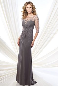 Montage by Mon Cheri. Stretch mesh and tulle slim A-line gown. Hand-beaded illusion three-quarter sleeves and bateau neckline. Sweetheart bodice with twisted center and keyhole back. Sweep train.