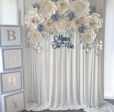 Boy themed baby shower decor, paper flower backdrop