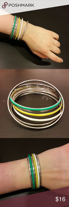 Thin Bangle Set in spring colours 7 thin bangles, look so cute together or each on their own. 4 silver, one bright yellow, one white, one turquoise. Originally from a boutique jewelry shop in Melbourne, Australia. Jewelry Bracelets