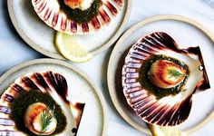 These seared scallops on the half shell make for a showstopping presentation. If your fishmonger can't order the shells for you, use small plates.