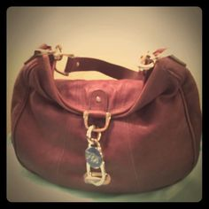 """Ted Baker Purple Leather Hobo Used but still good overall condition medium purple leather hobo. Some hardware shows wear and handle was repaired so no more peeling. Hardware is silver, interior is clean and no tears. Handle has a 9"""" drop. Still a great bag Ted Baker Bags Hobos"""