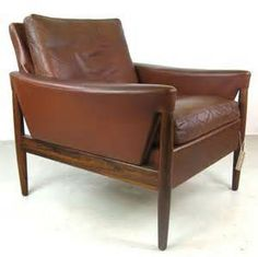 Kurt Ostervig designed leather easy chair on solid rosewood frame with ...