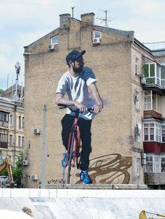 """Mural titled """"Red Bicycle"""" by Canadian artist Jarus in Kiev, Ukraine."""