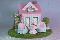 Shabby Chic Gingerbread House just gingerbread, royal icing and isomaltall our creations performed on the personal design, copyright...