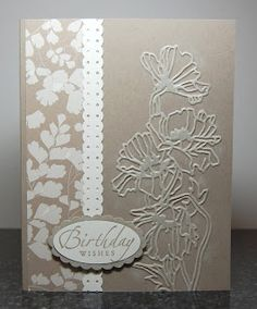 """By Karen Graff-Povis. Dry emboss front of brown card base, on the right side, using Stampin' Up/Sizzix """"Flower Garden"""" embossing folder. Sponge white shimmer paint (or white ink) over the raised edges. Add designer paper at left, white strip punched with """"Dotted Scallop Ribbon Border Punch"""" over right edge of designer paper, and sentiment."""