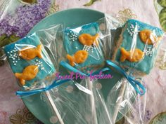 1 Dozen - Goldfish Rice Krispy Treats  Each one will come individually wrapped in a cellophane bag with a ribbon. If you would like them without