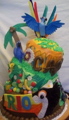 This is a great example of a Rio cake. Cake makes a great snack to munch on during movies – A Southern Outdoor Cinema movie snack & food idea for outdoor movie events. Rio Birthday Cake, Rio Birthday Parties, Birthday Ideas, 2nd Birthday, Cupcakes, Cupcake Cakes, Cupcake Ideas, Rio Cake, Rio Party