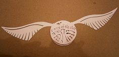 Paper craft snitch - Harry Potter. Including the resurrection stone, hidden inside :)