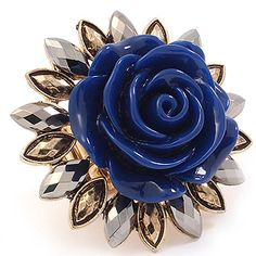"This ring is adjustable and stretches to fit most ladies. It is of Formica construction and shaped like a rose with an antique, beaded finish. The ring is metal casting and is 1 1/2"" tall.  Color: Blue $19.99"