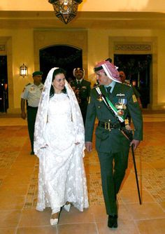 Jordanian Prince Hamzah bin Al Hussein and his wife Princess Noor at their wedding on May 27, 2004. The bride was beautiful in a white lace gown resembling a Takchita a Moroccan style garment. She wore a floor length white lace mantilla with white pumps with a high platform.