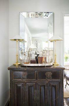 Pretty home bar set-up...lamps, mirror.