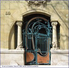 Le Castel Béranger entrance door, 14 rue la Fontaine - Paris, France XVI. Guimard's masterpiece of 1895-98 epitomises art nouveau in Paris. From outside you can see his love of brick and wrought iron, asymmetry and renunciation of harsh angles not found in nature. Green seahorses climb the façade, and the faces on the balconies are thought to be self-portraits, inspired by Japanese figures, to ward off evil spirits. A must see.
