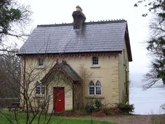 red door on a tiny cottage