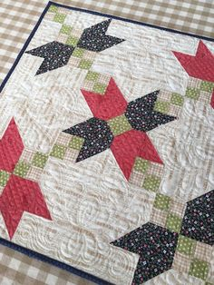 Carried Away Quilting's Crossing Petals mini quilt pattern sewn in Moda Fabrics: Little Miss Sunshine (Lella Boutique) and Farmhouse (Fig Tree & Company).