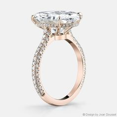 Chelsea by Jean Dousset, Starting at $13,000, with a 1 carat diamond center stone . More details: CHELSEA is a handcrafted Jean Dousset Diamonds solitaire engagement ring with three rows of diamonds on the band - jeandousset.com - pictured in Platinum with an Oval cut diamond.