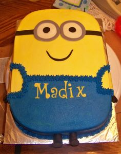 Minion - This is a minion cake iced in bc. with fondant accents. Could use sugar sheets
