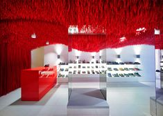 30 000 shoe laces adorn the ceiling of this Camper store. Camper store by Atelier Marko Brajovic Melbourne Australia Visual Merchandising, Camper Store, Retail Interior Design, Interior Ideas, Interior Inspiration, Clothing Displays, Red Shop, Commercial Interiors, Ceiling Design