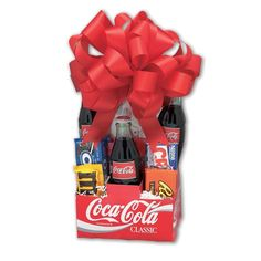 Surprise Coca-Cola lovers with this gift basket. Delivered in Coke's iconic red-and-white packing and topped with a red bow, the basket includes three classic single-serve Coca-Colas in old-fashioned Diy Food Gifts, Gourmet Gifts, Raffle Baskets, Gift Baskets, Snack Gift Basket, Coca Cola Classic, Coca Cola Gifts, Coca Cola Christmas, Christmas Gifts