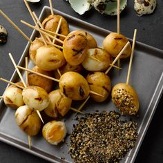 Soy grilled quail eggs with sesame salt I Ottolenghi recipes I These were inspired by a Japanese yakitori restaurant we often go to. The marinating and grilling gives the eggs a sweet, smoky aroma, accentuated by the milder sesame flavour. Ideally, they s