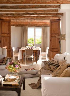 This cozy cottage shows off beautiful country home decorating in comfortable and charming French Provencal style. Bright and spacious home interiors with exposed wood ceiling designs offer gorgeous living spaces for ultimate relaxation. Lushome presents this beautiful country home decorating and int