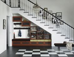 Asheville-Entryway-by-California-Closets-of-Michigan Under Stairs Storage: How to Maximize the Space from Your House Staircase Storage, Entryway Storage, Stair Storage, Entryway Ideas, Organized Entryway, Hanging Storage, Small Space Design, Small Space Storage, Small Spaces