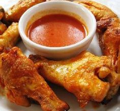 "UNBELIEVABLE BAKED BUFFALO WINGS  1 lb chicken wings  1 tablespoon cayenne pepper  1 teaspoon crushed red pepper flakes  1 tablespoon salt  1/2 cup louisiana hot sauce  1 tablespoon margarine    Directions:    1  Fill a large pot half way with water and then add the first 4 ingredients.  2  Bring water mixture and wings to a boil and then boil for 15 minutes.  3  Transfer wings to an oven safe container coated with cooking spray. Bake wings on ""Broil"" (high) for 15 minutes on each side."