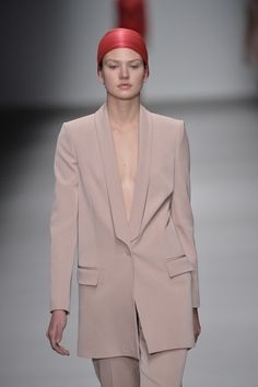 A dusty pink colour refreshes women's suiting at the @hakaanyildirim #LFW #AW15 show.