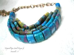 Handmade paper beads. What a great variation of the paper bead. Lovely
