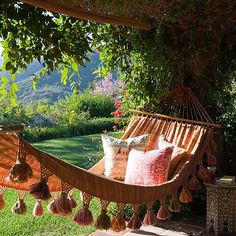 Hammocks pair perfectly (especially when tasseled) with a riot of patterned pillows and a decorative side table.
