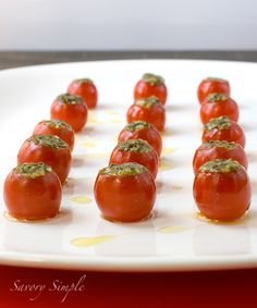 Pesto Tomato Bites ~ Savory Simple      30 cherry tomatoes      extra virgin olive oil      salt      Pesto      1/4 cup toasted pine nuts      1 clove garlic (or more to taste)      1 cups fresh basil leaves      1/4 cup Parmigiano-Reggiano, grated      1/4 extra-virgin olive oil      Salt and pepper, to taste
