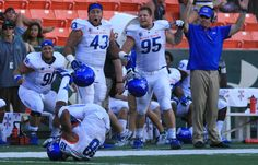 Boise State celebrating during 49 - 14 defeat over Hawaii!