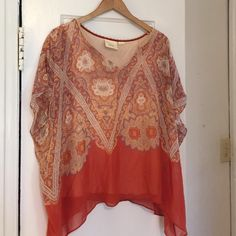 Boutique Flowy Top Beautiful paisley flowy top. Has attached camisole underneath so you don't have to worry about finding one that matches. Would look great with white jeans and gold hoops. Excellent condition. Tops Tunics