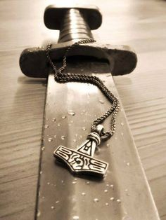 "Viking broad sword and Mjölnir (Thor's Hammer).  The Mjölnir has been adopted as a symbol worn by ""modern day"" Pagans to recognise each other,   Being of Norwegian extraction and also a Pagan I wear the Mjölnir, I have been amazed by how many people know what it signifies!"
