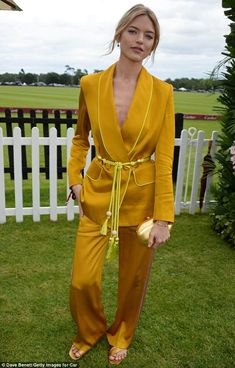 Cutting the mustard: Martha Hunt proved she dazzles in far more than lingerie on Sunday, as she made a sophisticated arrival at the Queen's Cup Polo Final in Windsor