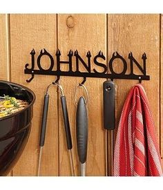 """Personalized Steel Name BBQ Tool Holder by Personal Creations. $39.99. Item Is Crafted Of Durable Steel And Features A Black Powder Coat Finish That Will Hold Up To Years Of Outdoor Use. Measures 11 1/2"""" L X 3 12"""" H, Has 5 Hooks And Features His Name In â??Flamingâ? Letters. We Personalize With Any Name, Up To 10 Characters. Mounting Hardware Not Included. Item Cannot Be Gift Boxed."""
