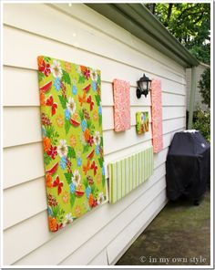 vinyl tablecloths turned into art for outside of house. iiiiinteresting.