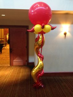 Large latex balloon with small mylar balloon shapes
