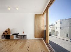 Home Design Minimalist Style Used Wooden Flooring Also White Wall Three-Storey Contemporary Home in Beautiful Appearance