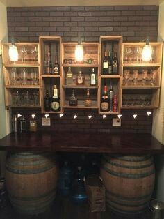 My bar build. Got the wine barrels from a flea market and built the countertop and crate shelves out of pallet wood. The lights are black gas pipe with mason jars and Edison light bulbs by keisha (Diy Bar Countertop)