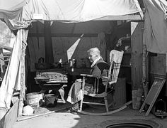Oh...bless her heart. Aged woman from Oklahoma. Kern County migrant camp, California, 1936