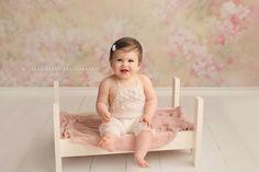 Baby girl sitter bed prop