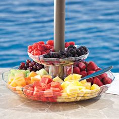 This two-tier serving tray is the ultimate space saver...it fits around your patio umbrella pole! #Solutions #SummerEntertaining