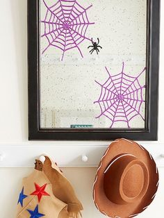 Tacky spider webs- Use puffy paint on plastic sheet protector, dry overnight, freeze for 20 minutes, peel and stick on a mirror or window!